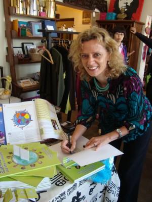 Lucinda signing books!