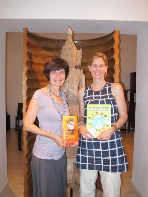 Authors sharing books: Kathryn Tonges with Susan Conley's 'The Foremost Good Fortune' and Susan with 'Slurping Soup'.