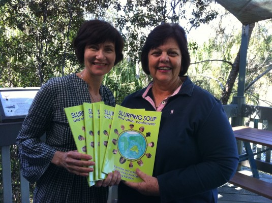 Supportive Gladstone Regional Council Mayor, Gail Sellers, with her 'Slurping Soup' purchases and co-author Kathryn Tonges.