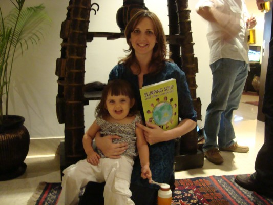 Michaela Stockey-Bridge with daughter Anouk at a party at Kerry's in New Delhi.